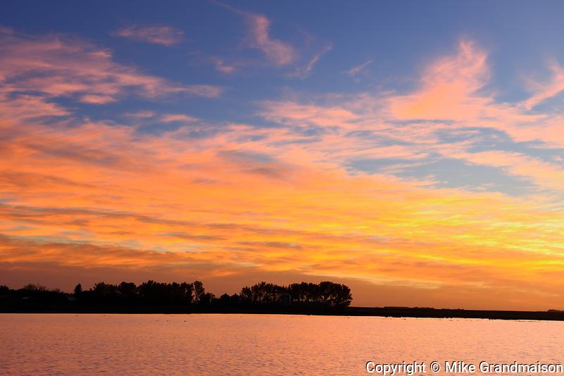 Sunset over wetland, Tuxford, Saskatchewan, Canada