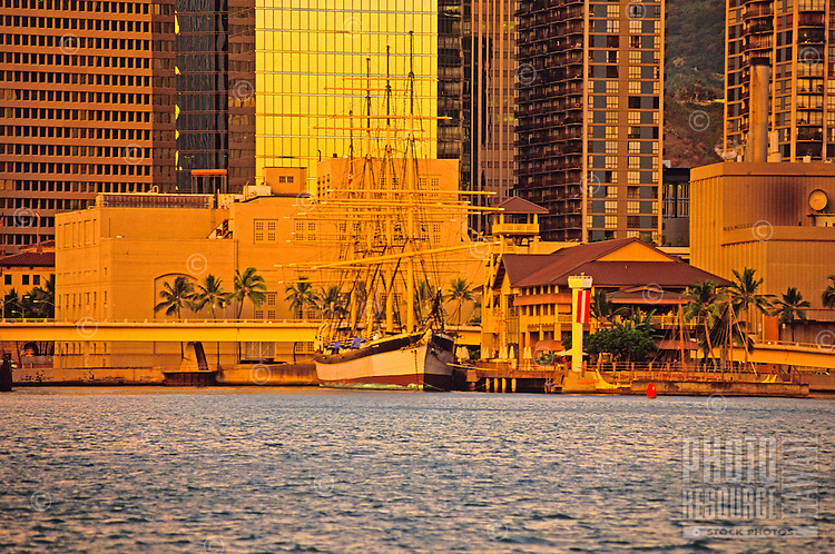 Late afternoon view of Hawaii Maritime Center & Falls of Clyde with downtown Honolulu in background, from Sand Island.