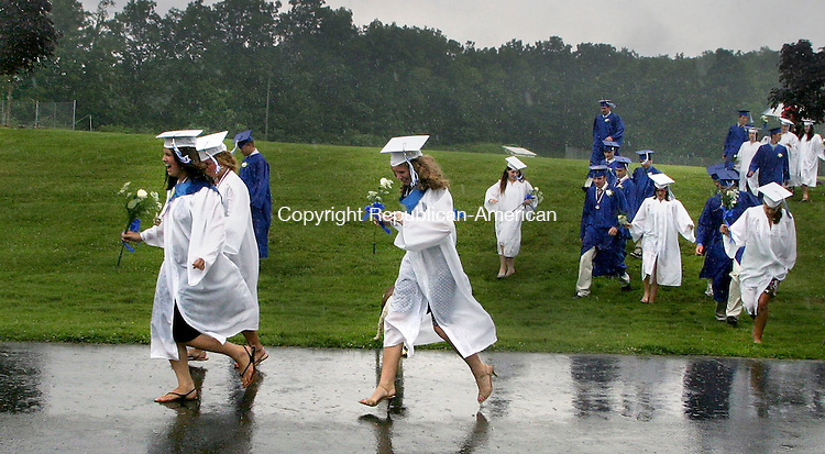 SOUTHBURY, CT- 24 JUNE 2006- 062406JW08.jpg  -- Shepaug Valley High School Class of 2006 students run for cover as a heavy rainfall interupts their Commencement Saturday afternoon. The event was moved into the school auditorium after the light shower turned into a deluge.  Jonathan Wilcox Republican-American