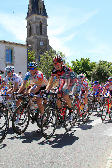 The pelethon including Omega Pharma-Lotto's Andre Greipel (GER) pass through the town of Vaire during the 3rd Stage of the 2011 Tour de France, 198k from Olonne-sur-Mere to Redon, 4th July 2011 (Photo by Eoin Clarke/NEWSFILE)