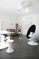 There is sufficient space in the large living/dining area for a dining table, sofa and an Eero Aarnio Ball chair