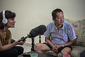 60 year old Cheng Ah Kow, a former pig farmer and a  survivor of the Nipah virus is interviewed by NPR's Michaeleen Doucleef in his house in Bukit Pelandok in Nageri Sembilan, Malaysia on October 16th, 2016. <br /> In September 1998, a virus among pig farmers (associated with a high mortality rate) was first reported in the state of Perak in Malaysia. Dr. Chua investigated and discovered the virus and it was later named, Nipah Virus. The outbreak in Malaysia was controlled through the culling of &gt;1 million pigs.