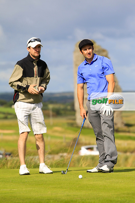 Eoin O'Brien (Dun Laoghaire) and his caddy on the 13th tee during Round 2 of The South of Ireland in Lahinch Golf Club on Sunday 27th July 2014.<br /> Picture:  Thos Caffrey / www.golffile.ie