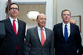 US Treasury Secretary Steven Mnuchin (L), US Commerce Secretary Wilbur Ross (C) and Director of the Office of US Trade Representative Robert Lighthizer (R) attend the signing of a presidential proclamation on steel and aluminum tariffs by US President Donald J. Trump, in the Roosevelt Room of the White House in Washington, DC, USA, 08 March 2018. President Trump is imposing tariffs on steel and aluminum imports. A decision to impose the tariffs on Canada or Mexico will not be decided until negotiations on the North American Free Trade Agreement (NAFTA).<br /> Credit: Michael Reynolds / Pool via CNP