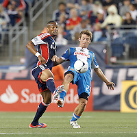 New England Revolution defender Darrius Barnes (25) and Philadelphia Union forward Antoine Hoppenot (29) battle for the ball. In a Major League Soccer (MLS) match, the New England Revolution tied Philadelphia Union, 0-0, at Gillette Stadium on September 1, 2012.