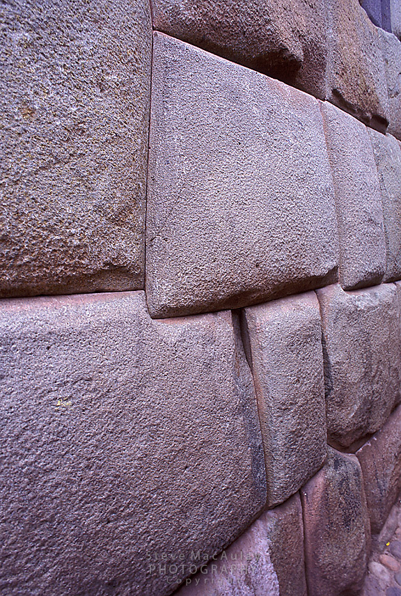 Close-up of incredibly precise fit of massive carved stone blocks that still provide a foundation for buildings in daily use today. Cusco, Peru.