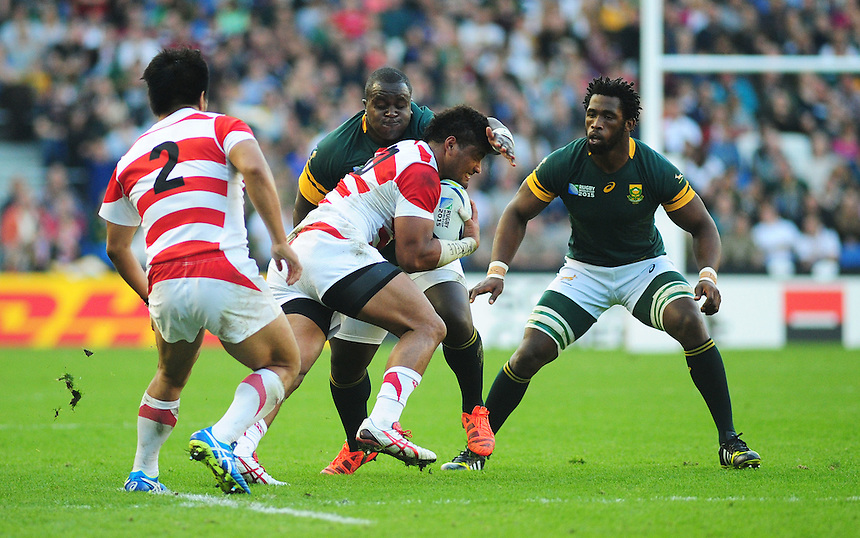 Japan's Amanaki Mafi is tackled by South Africa's Trevor Nyakane<br /> <br /> Photographer Kevin Barnes/CameraSport<br /> <br /> Rugby Union - 2015 Rugby World Cup - Japan v South Africa - Saturday 19th September 2015 - The American Express Community Stadium - Falmer - Brighton<br /> <br /> &copy; CameraSport - 43 Linden Ave. Countesthorpe. Leicester. England. LE8 5PG - Tel: +44 (0) 116 277 4147 - admin@camerasport.com - www.camerasport.com