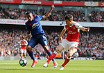 Arsenal's Laurent Koscielny tussles with Manchester United's Anthony Martial during the Premier League match at the Emirates Stadium, London. Picture date: May 7th, 2017. Pic credit should read: David Klein/Sportimage