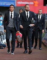 (L-R) Matrin Olsson and Kristoffer Nordfeldt of Swansea City arrive prior to the game during the Premier League match between Swansea City and Watford at The Liberty Stadium, Swansea, Wales, UK. Saturday 23 September 2017