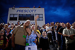 Prescott residents pray at  a vigil for the Granite Mountain Hotshots, 19 of who perished in the Yarnell Fire Sunday at Prescott High School in Prescott, Arizona, July 2, 2013.
