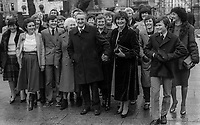 Dan Wallace, TD, Fianna Fail, politician, Rep of Ireland, pictured arriving Leinster House for the opening of the recently-elected Dail Eireann, Irish Parliament, 14th December 1982, with wife, family members, and supporters,198212140318DW2<br /> <br /> Copyright Image from Victor Patterson, 54 Dorchester Park, <br /> Belfast, UK, BT9 6RJ<br /> <br /> t1: +44 28 9066 1296 (from Rep of Ireland 048 9066 1296)<br /> t2: +44 28 9002 2446 (from Rep of Ireland 048 9002 2446)<br /> m: +44 7802 353836<br /> <br /> victorpatterson@me.com<br /> www.victorpatterson.com<br /> <br /> Please see my Terms and Conditions of Use at VICTORPATTERSON.COM. It is IMPORTANT that you familiarise yourself with them.<br /> <br /> Images used on the Internet must be visibly watermarked i.e. &copy;VICTORPATTERSON.COM within the body of the image and copyright metadata must not be deleted. Images used on the Internet have a size restriction of 4kbs and are chargeable at the then current NUJ rates.<br /> <br /> This image is only available for the use of the download recipient i.e. television station, newspaper, magazine, book publisher, etc, and must not be passed on to any third party. It is also downloaded on condition that each and every usage is notified within 7 days to victorpatterson@me.com<br /> <br /> The right of Victor Patterson to be identified as the author is asserted in accordance with The Copyright Designs And Patents Act (1988).