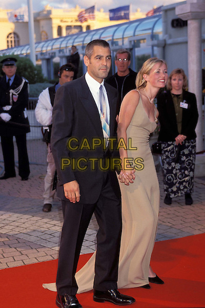 GEORGE CLOONEY & ex GIRLFRIEND..Ref: 7726..shaved hair, long beige dress, red carpet, holding hands,  ..full length, full-length..www.capitalpictures.com..sales@capitalpictures.com..©Capital Pictures..