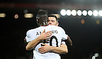 Michail Antonio celebrates with Aaron Cresswell of West Ham United after scoring during the Premier League match at Anfield Stadium, Liverpool. Picture date: December 11th, 2016.Photo credit should read: Lynne Cameron/Sportimage