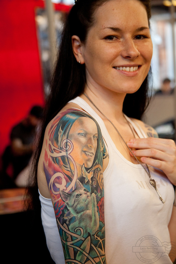 Copenhagen Inkfestival 2012. Tattooed portrait with kitten and butterfly