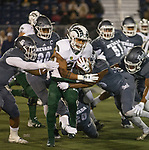 Colorado State running back Izzy Matthews (24) is hit by the Nevada defense in the first half of an NCAA college football game in Reno, Nev., Saturday, Nov. 10, 2018. (AP Photo/Tom R. Smedes)