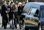 The family of Cpl. Steven R. Koch walks behind the hearse carrying his body during the funeral procession towards the Our Lady of Lourdes Roman Catholic Church in Milltown. Koch was killed in Afghanistan last week a memorial service was held at the church today and he will be buried in Arlington National Cemetery in Washington DC on Friday. <br /> <br /> <br /> METRO<br /> ON THURS. MARCH 13,2008<br /> 0907<br /> MARK R. SULLIVAN/CHIEF PHOTOGRAPHER