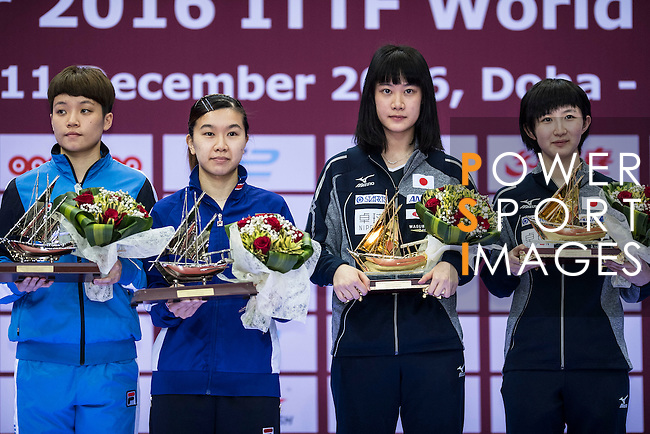 Doo Hoi Kem and Lee Ho Ching of Hong Kong (l) during the prize ceremony with Yui Hamamoto and Hina Hayata of Japan (r) after finishing the Seamaster Qatar 2016 ITTF World Tour Grand Finals at the Ali Bin Hamad Al Attiya Arena on 11 December 2016, in Doha, Qatar. Photo by Victor Fraile / Power Sport Images