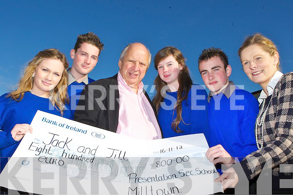 Milltown Presentation students present Jonathan Irwin the CEO of the Jack and Jill Foundation a cheque of ?800 when he visited the school on Thursday l-r: Emma O'Sullivan, Gavin Casey, Jonathan Irwin ,Amy Cahill, Chris Flynn and  Miss Mary Costello.