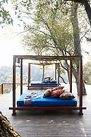 Daybeds give a stunning view overlooking the surrounding countryside from a terrace of the Singita Pamushana Lodge, Malilongwe Trust, Zimbabwe