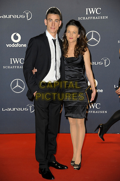 Laurent Koscielny & guest.Arrivals at the Laureus 2012 World Sports Awards held at the Queen Elizabeth II Centre, London, England..February 6th, 2012.full length black suit dress white shirt.CAP/CAS.©Bob Cass/Capital Pictures.