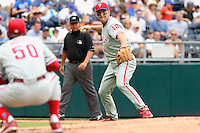 Philadelphia Phillies third baseman Wes Helms makes a throw to first base as Jamie Moyer ducks out of the way during the first inning at Kauffman Stadium in Kansas City, Missouri on June 10, 2007.  The Royals won 17-5.