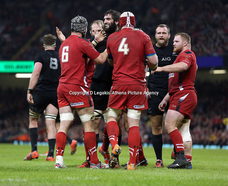 Pictured: A fight breaks out between Sam Whitelock(C) of New Zealand and Wales players Saturday 22 November 2014<br />
