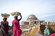 Migrant labourers from Rajasthan are seen working on the Asia's Biggest Dome, the Kashi Ram Smarak (monument) built by Uttar Pradesh chief minister, Mayawati in Lucknow, India. The dalit chief minister, Mayawati is channeling huge state funds into making statutes of herself with her mentor, Kashi Ram all across Lucknow.