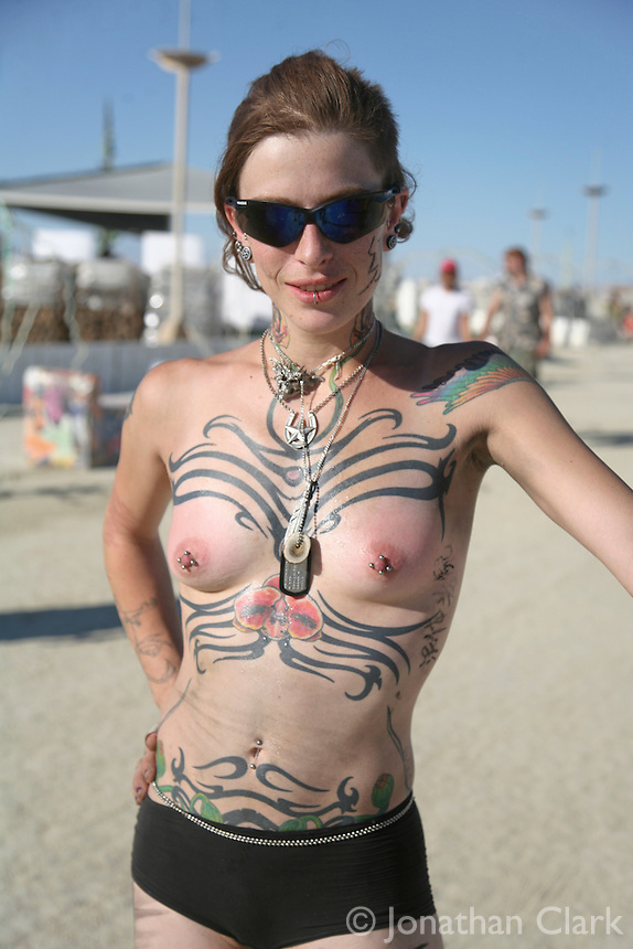 Woman with tribal tattoos. Burning Man is an eight-day annual event that takes place in Black Rock City, a temporary city on the playa of the Black Rock Desert in the U.S. state of Nevada, 90 miles (150 km) north-northeast of Reno, ending on the American Labor Day holiday in September. The event is described by organizers as an experiment in community, radical self-expression, and radical self-reliance and takes its name from the ritual burning of a large wooden effigy on Saturday evening.