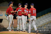Fort Myers Miracle relief pitcher Calvin Faucher (12) hands the ball to manager Toby Gardenhire (33) for a pitching change as third baseman Jose Miranda, shortstop Royce Lewis, and first baseman Ryan Costello look on during a Florida State League game against the Bradenton Marauders on April 23, 2019 at LECOM Park in Bradenton, Florida.  Ryan Costello is at left.  Fort Myers defeated Bradenton 2-1.  (Mike Janes/Four Seam Images)
