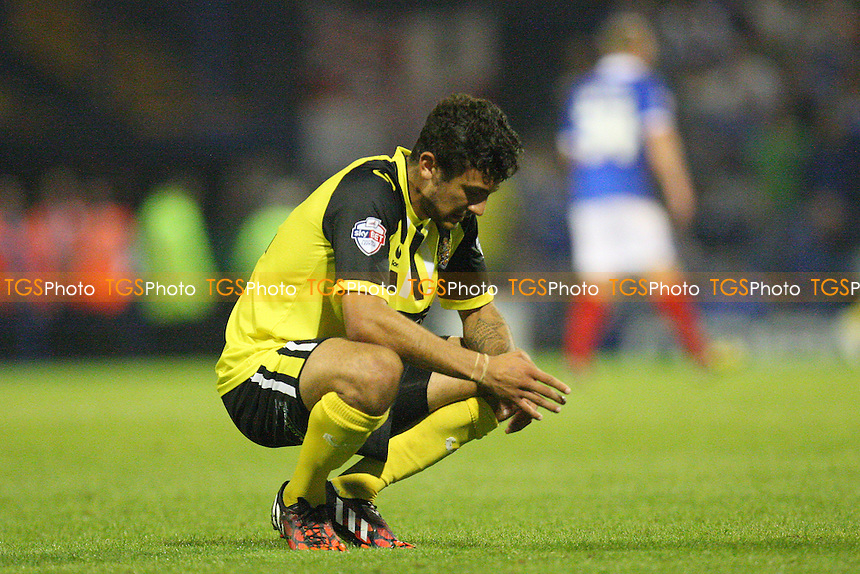 George Porter of Dagenham and Redbridge looks despondent at the final whistle - Portsmouth vs Dagenham and Redbridge - Sky Bet League Two action at the Frratton Park Stadium on 16/09/2014 - MANDATORY CREDIT: Dave Simpson/TGSPHOTO - Self billing applies where appropriate - 0845 094 6026 - contact@tgsphoto.co.uk - NO UNPAID USE
