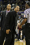 Lorenzo Romar argues a call with an official during the Huskies Pac-10 conference home game against arch-rival Washington State at Bank of America Arena in Seattle, Washington, on January 30, 2010.