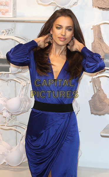 Irina Shayk (Irina Shaykhlislamova).launches Intimissimi Perfect Bra Collection and book at.Intimissimi, Oxford Street, London, England..24th April 2012.half length blue dress black belt wrap hands arms.CAP/ROS.©Steve Ross/Capital Pictures.