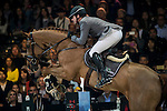 Philipp Weishaupt of Germany rides Carinou in action at the Longines Grand Prix during the Longines Hong Kong Masters 2015 at the AsiaWorld Expo on 15 February 2015 in Hong Kong, China. Photo by Juan Flor / Power Sport Images