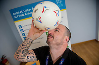 Friday 10 February 2017<br /> Pictured: Faults advisor Mathew Davies balances a football on his head <br /> Re:Welsh Government Dementia Risk Prevention Roadshow at the BT building, Swansea, Wales, UK
