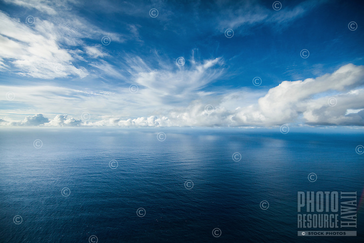 Clouds stretch across an empty ocean off the coast of Kaua'i.