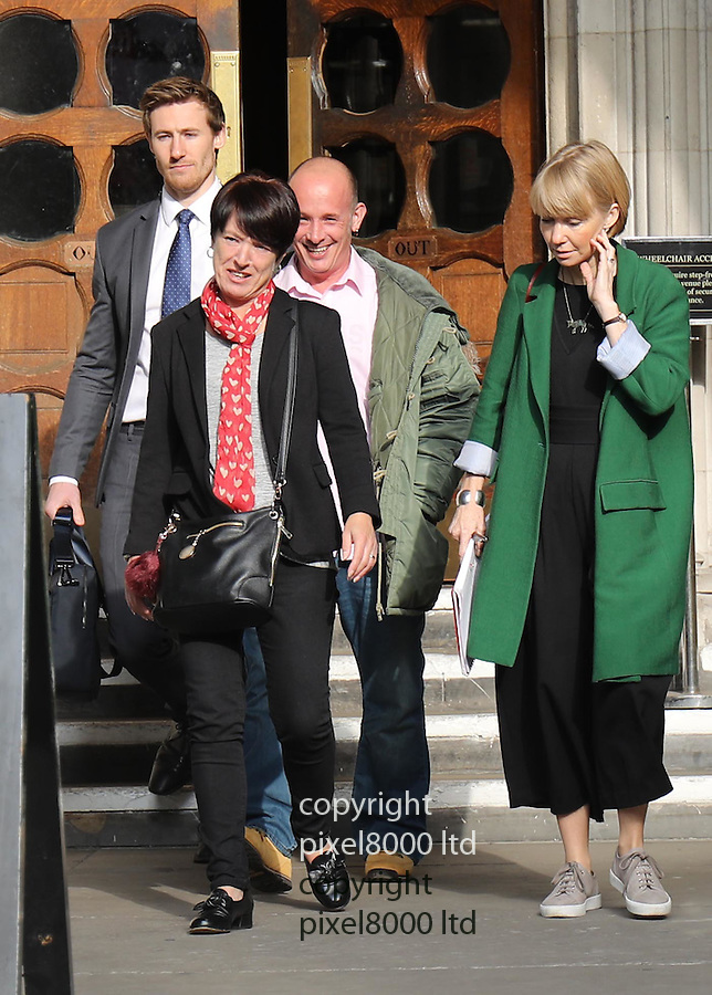 "Pic shows: Private Sean Benton's twin brother Tony Benton and sister Tracy Lewis leave the High Court in London today.<br /> 14.10.16<br /> <br /> A fresh inquest can take place into the death of a young soldier at an army barracks in Surrey 21 years ago, a high court judge has ruled.<br /> Pte Sean Benton, from Hastings, was found with five bullet wounds to his chest in June 1995 while undergoing training at Deepcut.<br /> An original inquest into his death recorded a verdict of suicide.<br /> His family applied for a new hearing after using the Human Rights Act to access evidence held by police.<br /> His twin, Tony Benton, and sister, Tracy Lewis, wept and said: ""We are just happy and relieved. It's been too long.""<br /> Justice Collins said fresh evidence had ""come to light which casts some doubt upon the correctness"" of the original decision.<br /> He added that under article two of the Human Rights Act there was material that questioned the care Pte Benton received from the army at the time.<br /> <br /> <br /> <br /> Pic by Gavin Rodgers/Pixel 8000 Ltd"