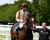 Dane O'Neil onboard Initiative is led into the winners enclosure after winning The Bathwick Tyres Novice Auction Stakes(plus 10, Div 1) during Afternoon Racing at Salisbury Racecourse on 13th June 2017