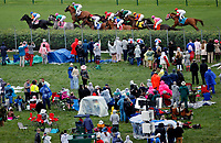LOUISVILLE, KY - MAY 05: The field enters the third turn during the Twin Spires Turf Sprint as fans watch from the infield on Kentucky Oaks Day at Churchill Downs on May 5, 2017 in Louisville, Kentucky. (Photo by Jon Durr/Eclipse Sportswire/Getty Images)