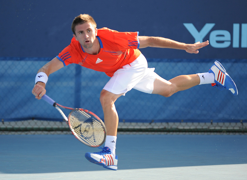 Tim Smyczek (USA) in action during his victory over Jurgen Melzer (AUT) in their first round match today - Tim Smyczek (USA) def Jurgen Melzer (AUT) 6-4 2-6 7-5..ATP 250 Tennis - 2012 Delray Beach International Tennis Championships - Day 2 - Tuesday 28 February 2012 - Delray Beach Stadium & Tennis Center - Delray Beach - Florida - USA..