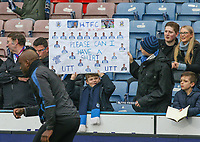 A young Huddersfield Town fan holds up a request for a player's shirt<br /> <br /> Photographer Alex Dodd/CameraSport<br /> <br /> The Premier League - Huddersfield Town v Swansea City - Saturday 10th March 2018 - John Smith's Stadium - Huddersfield<br /> <br /> World Copyright &copy; 2018 CameraSport. All rights reserved. 43 Linden Ave. Countesthorpe. Leicester. England. LE8 5PG - Tel: +44 (0) 116 277 4147 - admin@camerasport.com - www.camerasport.com