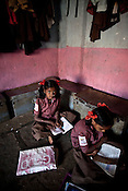 9 year old Ashwini Magamvangar attends her classes in a government run school in Caregaon, Thane, Maharashtra. Students from lower income group families attend the class during the day and later at night sleep in the same classroom. These schools run a specially designed concept of 'aflatoon' as part of the curriculam whereby students are made aware of their child as described in the convention of rights of child. These students are made aware of right to survival, right to protection, right to development and right to participation.