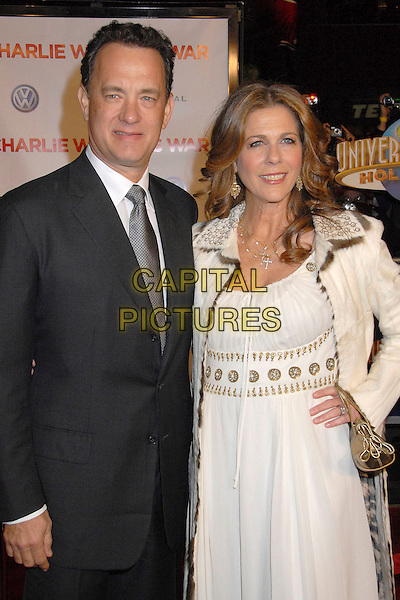 "TOM HANKS & RITA WILSON.""Charlie Wilson's War"" Los Angeles Premiere at Universal City Walk, Universal City, California, USA,.10 December 2007..half length white cream gold dress coat hand on hip married husband wife.CAP/ADM/BP.©Byron Purvis/AdMedia/Capital Pictures."
