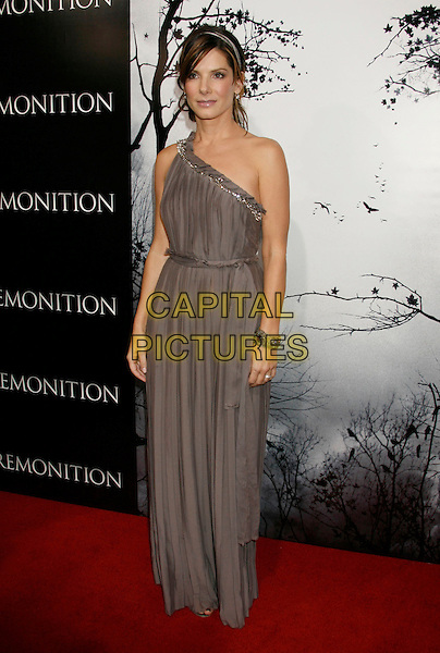 "SANDRA BULLOCK .""Premonition"" World Premiere held at the ArcLight Cinerama Dome Theatre, Hollywood, California, USA..March 12th, 2007.full length purple grey gray one shoulder dress silver bracelet pleated.CAP/ADM/RE.©Russ Elliot/AdMedia/Capital Pictures"
