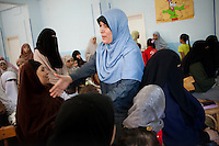 Dr Omaima Kamel, a 51-year-old Muslim Sister, greets women of Al Saf village assembled at the school to attend her speech. Egypt, June 2012.