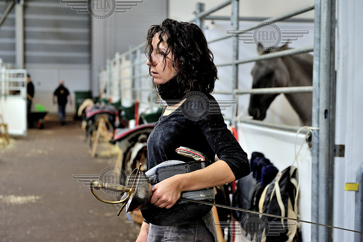 Emmanuelle, a rider with the Versailles Academy of equestrian arts (Academie equestre de Versailles), backstage before a performance in Geneva.