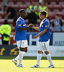 USA team mates Maurice Edu and Alejandro Bedoya celebrate together at the end