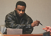 Karl Largie, manager at Tropicana resturant in Washington D.C., hands back a pointer during his testimony in the trial of sniper suspect John Allen Muhammad in courtroom 10 at the Virginia Beach Circuit Court in Virginia Beach, Virginia on October 28, 2003. <br /> Credit: Adrin Snider - Pool via CNP