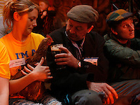 Fergie Fox, from Co. Louth, shares his pint with a rooster at a nightclub.<br />