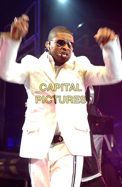 USHER.Performs during a tour stop on his 'The Truth Tour' held at Mellon Arena..October 7th, 2004.stage, concert, live, music, gig, singing, half length, white suit, dancing, arms in air, gesture.www.capitalpictures.com.sales@capitalpictures.com.© Capital Pictures.
