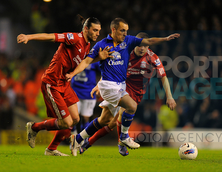 Andy Carroll of Liverpool tussles with Leon Osman of Everton.Barclays Premier League match between Liverpool v Everton at Anfield, Liverpool on the 13th March 2012..Sportimage +44 7980659747.picturedesk@sportimage.co.uk.http://www.sportimage.co.uk/.